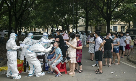 Residents line up to be tested for COVID-19 in Wuhan