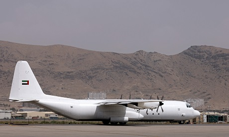 An aircraft carrying boxes of aid from the UAE is pictured at the airport in Kabul. (Photo / AFP)