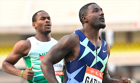 Justin Gatlin of the US (R) and Nigeria