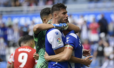 Alaves players celebrate after defeating Atletico Madrid at the end of a Spanish La Liga soccer matc