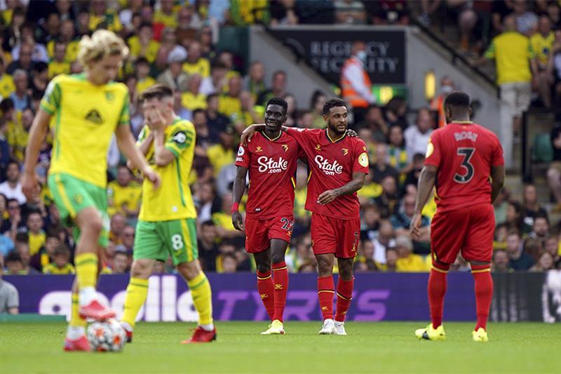 NEW Watford s Ismaila Sarr, center left, celebrates scoring. AP