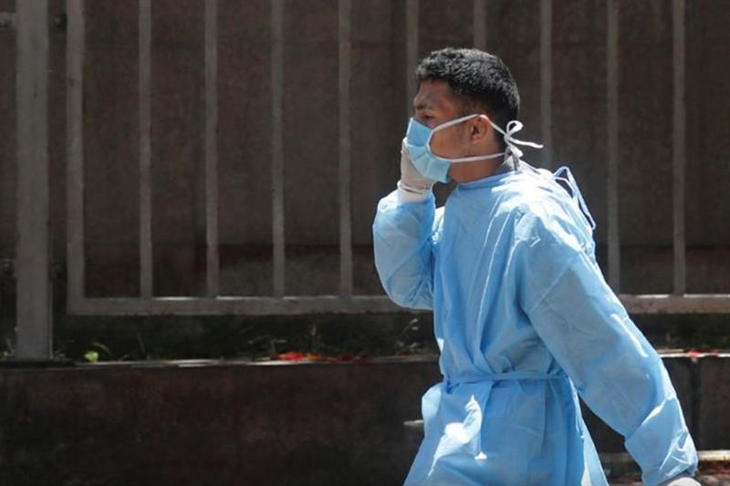 FILE PHOTO: A medical staff member wearing face mask to prevent the spread of the coronavirus diseas