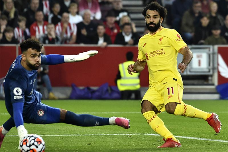 Liverpool s Mohamed Salah, right, scores his side s second goal during the English Premier League so