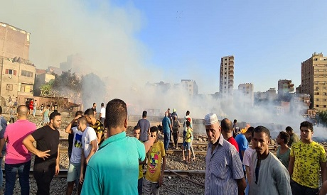 Destructive fire burns down 12 wood selling shops in Cairo